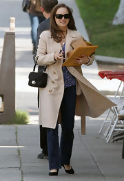 Natalie Portman looked ladylike running errands in a khaki trench coat.