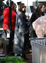Naya Rivera bundled up in an oversized gray coat while filming in West Hollywood.