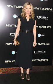 Michelle Pfeiffer gave her black dress the perfect amount of shine with a tasteful gilded box clutch at the 'New Year's Eve' premiere.