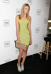 Heather wears a sassy lime green body con dress for the Herve Leger NY fashion show.