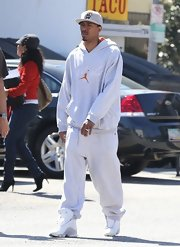 Nick Cannon's casual daytime look was topped off with this gray hoodie.