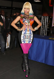 Nicki looked fashion forward as ever in black lace up cut-out boots. She wore the leather knee-highs over hot pink tights.