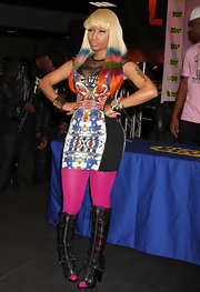 Nicki dons a mini print dress with her new rainbow hair. Just her style!