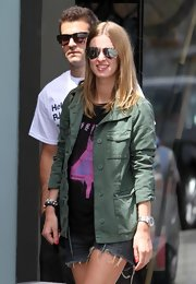 Nicky always looks casually cool while out and about in Malibu. She donned a silver watch with her cut-off shorts and green jacket.