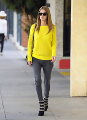 Nicky Hilton topped off her bright sweater with black ankle boots complete with embellished detailing.