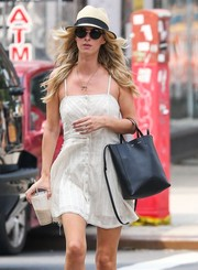 Nicky Hilton got some sun protection from a pair of round sunnies and a fedora while out on a stroll in New York City.