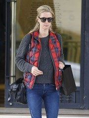 Nicky Hilton stepped out of Barneys New York wearing cool round sunglasses.