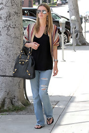 Nicky Hilton kept her look casual with black flip flops.