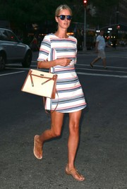 For a touch of luxe, Nicky Hilton accessorized with a cream and tan Hermes Kelly bag.