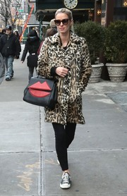 Nicky Hilton gave her casual jeans a glam boost with a leopard-print fur coat.
