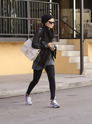 Nicole Richie paired her casual look with a jumbo Chanel classic flap bag.