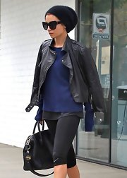 Nicole Richie chose a classic leather jacket to drape over her shoulders while leaving the gym after a workout.