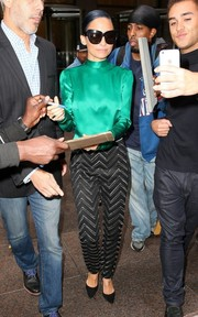 Nicole Richie went for some shimmery sophistication in an emerald-green silk blouse by Blumarine during her Sirius Radio interview.
