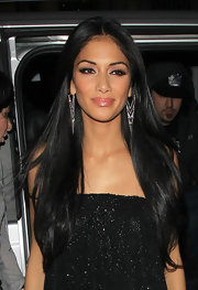 Nicole Scherzinger arrived at a nightclub in London wearing her ultra-long hair sleek and straight.