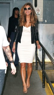 Nicole Scherzinger layered a black leather jacket over a little white dress for a tough-chic vibe.