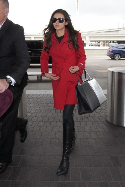 Nina Dobrev styled her airport look with a two-tone leather tote by Fendi.