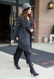 Nina Dobrev completed her winter-chic ensemble with black knee-high boots.