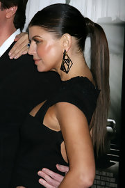 "Fergie shows off her sleek center parted ponytail on the red carpet of the LA premiere of ""Nine""."