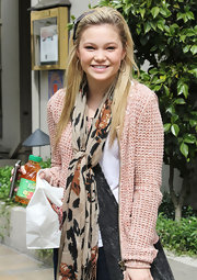 This patterned scarf was the perfect accessory to tie together Olivia Holt's outfit.