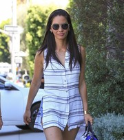 Olivia Munn shaded her eyes behind a pair of sporty round sunglasses while strolling in Beverly Hills.