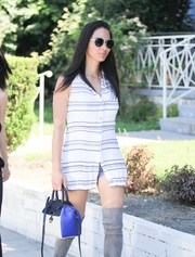 Olivia Munn teamed a tricolor leather tote with a striped top and thigh-high boots for a day out in Beverly Hills.