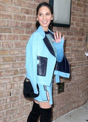 Olivia Munn stepped out in New York City sporting a Loeffler Randall suede bag and Versace leather skirt suit combo.