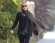 Olivia Newton-John wore a  leopard print scarf while out in Santa Monica.
