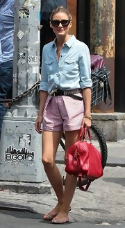 Olivia paired her classic chambray top with printed pink gingham shorts for a preppy meets city look.