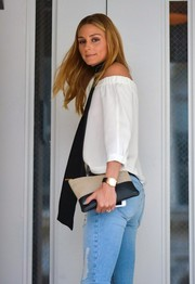 Olivia Palermo was spotted out in New York City carrying a Celine bicolor lambskin clutch.