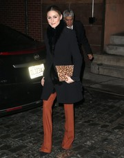 Olivia Palermo spiced up her look with a leopard-print clutch by Aerin.