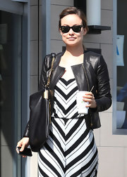 Olivia Wilde sharpened her graphic striped maxi with a collarless leather jacket and wayfarer shades.