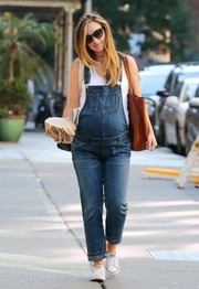 Expectant mom Olivia Wilde kept it laid-back and cute in denim overalls while out in New York City.