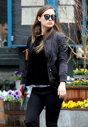 Olivia Wilde took a stroll in New York City wearing a pair of Karen Walker Harvest sunglasses.