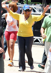 Oprah Winfrey looked laid-back in a yellow knit faux-wrap top while touring Bondi.