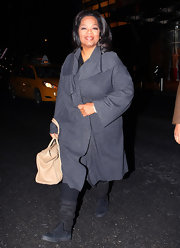 Oprah Winfrey covered up with a baggy gray wool coat during a dinner out in New York City.
