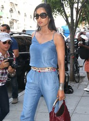 Padma Lakshmi headed out in New York City wearing a chambray jumpsuit styled with a coin-embellished belt.