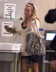 Pamela Anderson carried a woven textile tote through LAX.