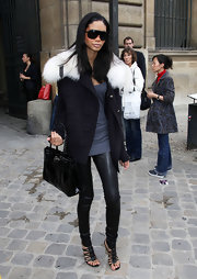 Chanel is looking trendy rocking black leather pants. She is wearing a perfect black leather wedge sandal.