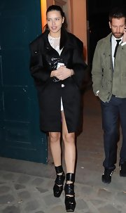 The stunning supermodel strutted her stuff in a chunky pair of cutout platform boots.