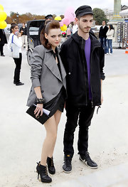 Roxanne showed off Fall 2010 ankle boots while attending Paris fashion week.