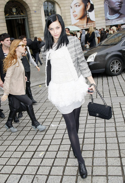 Leigh attending Paris Fashion Week toting a coveted quilted Flap bag.