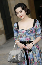 Fan showed off a monogram Fall 2010 handbag, which she paired with a floral dress from the same collection.