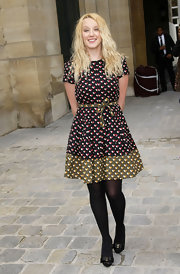 Ludivine Sagnier showed off her printed day dress while hitting the Louis Vuitton Spring 2011 fashion show.