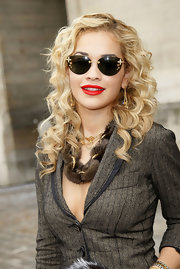 Brtiannigue showed off her blond curls while making her way into the Louis Vuitton fashion show.