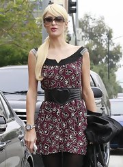 Paris paired her telephone-print dress with a leather heart belt. The heiress loves her playful accessories.