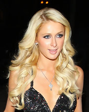 Paris Hilton headed out in Hollywood wearing her hair in long shiny curls.