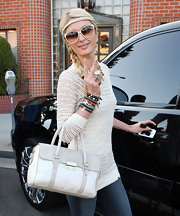 Paris Hilton wore her hair in a long side braid with headband accent while leaving her Beverly Hills office.