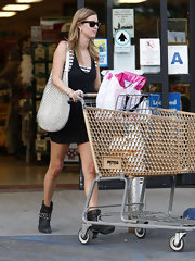 Nicky Hilton was spotted doing some grocery shopping where she showed off a heavily studded white shoulder bag.