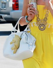 "Paris wore the bright turquoise ""Deco Cuff Bracelet"" with her sunny Spring look."