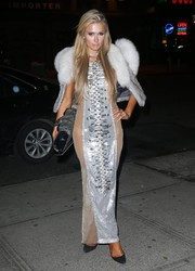 Paris Hilton was a head-turner in a silver The Blonds gown with a beaded front and see-through sides while out in New York City.